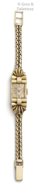 Bracelet-montre de dame en or jaune, boîtier...