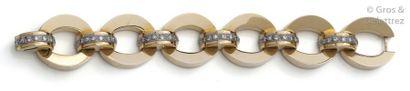 Bracelet articulé en or rose ornée de six...