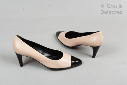 CHANEL Pair of nude lambskin and black glazed leather pumps, 70mm composite heels,...