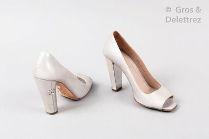 CHANEL Pair of peep-toe pumps in pearly patent leather, 100mm covered heels, partially...