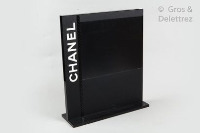 CHANEL Black composite display stand with a padded band adorned with the name of...