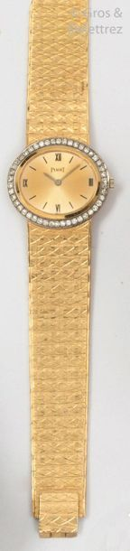 PIAGET Yellow gold watchband, oval case, gold dial with Roman numerals, bezel set...