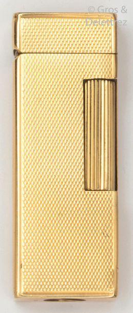 Briquet en or jaune guilloché. P.Brut?:97...