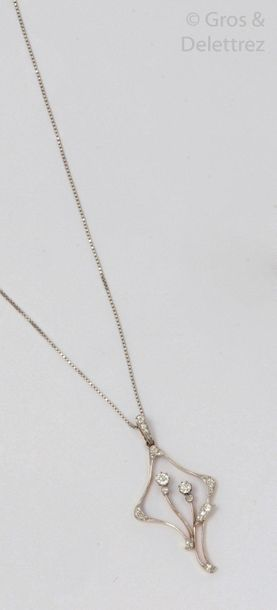 Chain and pendant in white gold, adorned with a floral motif set with antique cut...