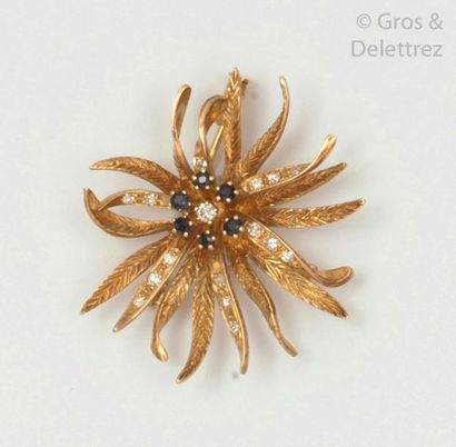 """Brooch """"Fleur"""" in chiselled yellow gold, adorned in the centre with a brilliant-cut..."""
