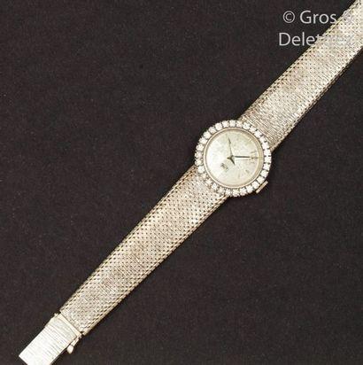 Bracelet-montre de dame en or gris, cadran...
