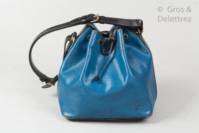 """LOUIS VUITTON Bag """"Petit Noé"""" in blue leather, black, closing by a sliding link,..."""