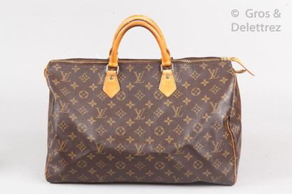 """LOUIS VUITTON Bag """"Speedy"""" 40 cm in monogram canvas and natural leather, double handle,..."""