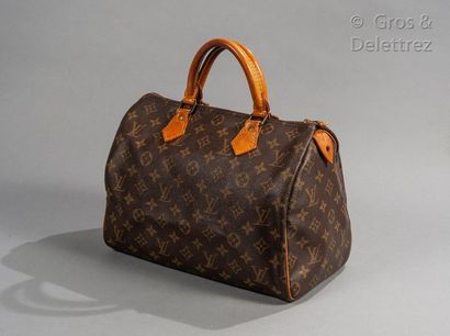 """LOUIS VUITTON Speedy"""" bag 30cm in Monogram canvas and natural leather, zip closure,..."""