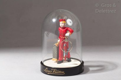 LOUIS VUITTON Globe on a bakelite base representing a groom of the House, holding...