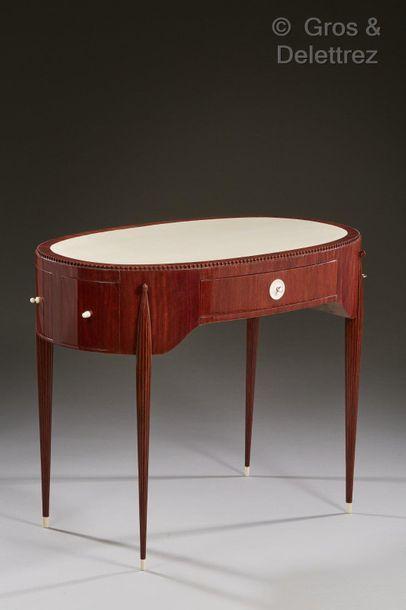 JACqUes-éMIle rUhlMAnn (1879-1933) Bureau modèle « Damovale » en bois d'amarante...