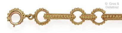Bracelet souple en or jaune à décor de torsades...