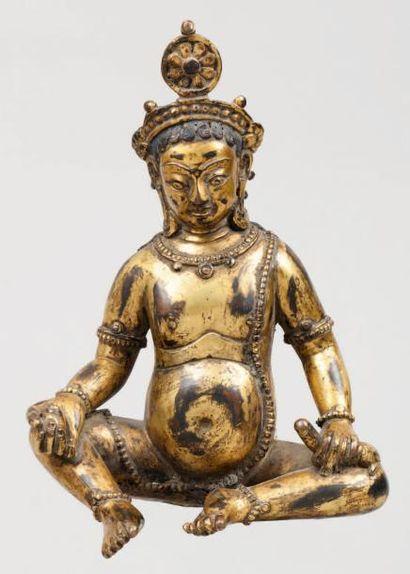 Bronze doré représentant Kubera assis tenant...