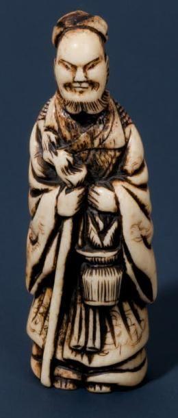 Netsuké en corne de cerf représentant Senin...