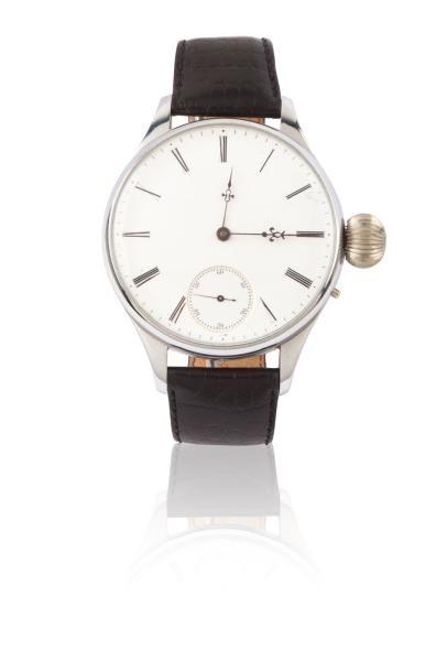 ANONYME Originale montre bracelet (remontage) en métal chromé. Fond transparent....