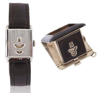 Lot de 2 montres en métal chromé à guichets...