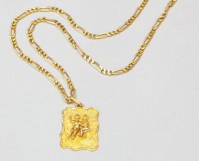 Chaîne et pendentif en or jaune représentant...