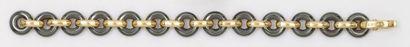 Bracelet articulé en or jaune et maillons...