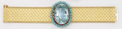 Bracelet souple en or jaune mat et poli orné...