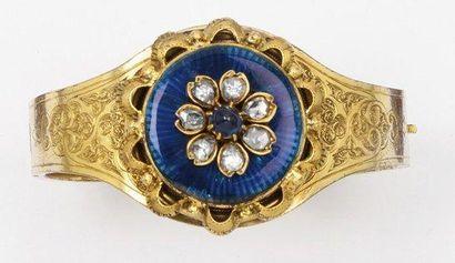 Bracelet jonc ouvrant en or jaune 14k ciselé...