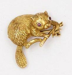 Broche «Castor» en or jaune, les yeux sertis...