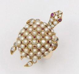 Bague «Tortue» en or jaune ornée de perles...