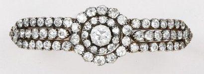 Bracelet en or jaune et argent serti de diamants....