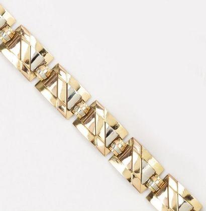 Bracelet articulé en or de trois couleurs...