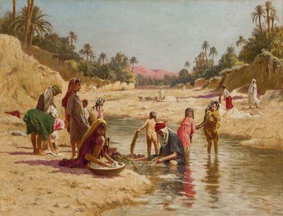 Alexis DELAHOGUE (1867-1953) Lavandières dans l'Oued de Gabès Huile sur toile, signée...
