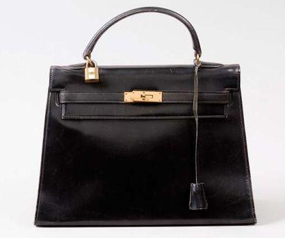 HERMES Paris *Sac «Kelly» 32 cm en cuir noir,...
