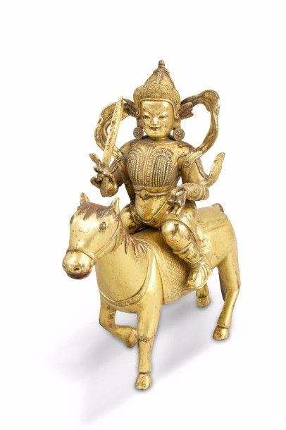 Groupe en bronze doré, représentant un cavalier...