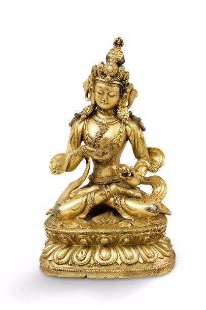 Statuette en bronze doré, représentant un...