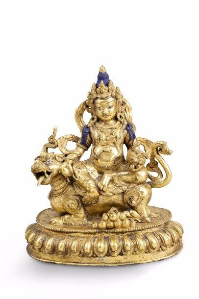 Groupe en bronze doré représentant le dieu...