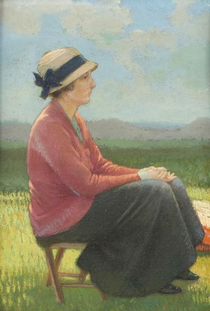 Jeune femme au chapeau de paille assise dans...