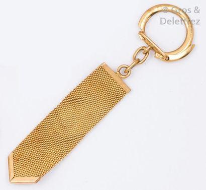 Porte clef en or jaune à maille résille....