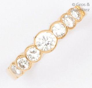 Bague «jarretière» en or jaune ornée de diamants...