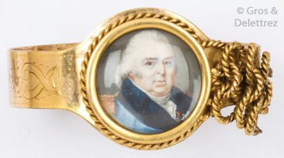 Bracelet rigide ouvrant en or jaune orné,...