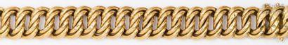 Bracelet en or jaune à maillons gourmette....