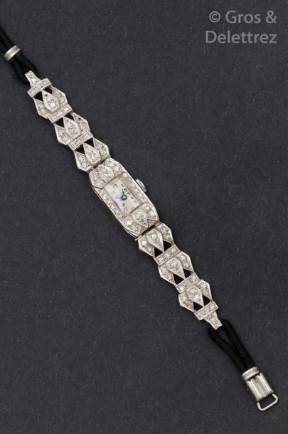 Bracelet-montre de dame en or gris. Cadran...