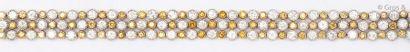 Bracelet souple en or de deux couleurs ornés...