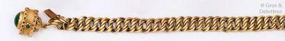 Bracelet articulé en or jaune orné d'une...