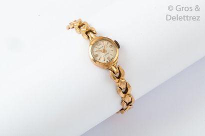 Bracelet-montre en or jaune, cadran blanc,...