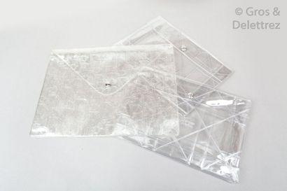 CHRISTIAN DIOR Lot composé de trois pochettes, une 31cm en PVC Dior oblique, les...