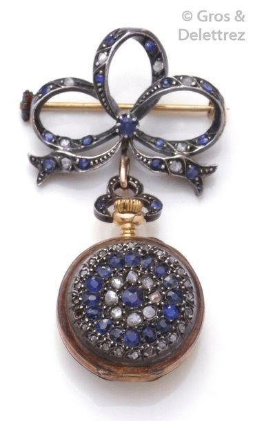 Broche porte-montre et sa montre en argent...