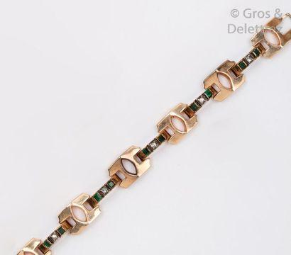 Bracelet en or rose 14K, les maillons articulés...