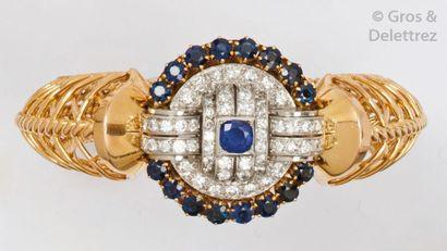 Bracelet «?Torsade?» en or jaune et platine,...