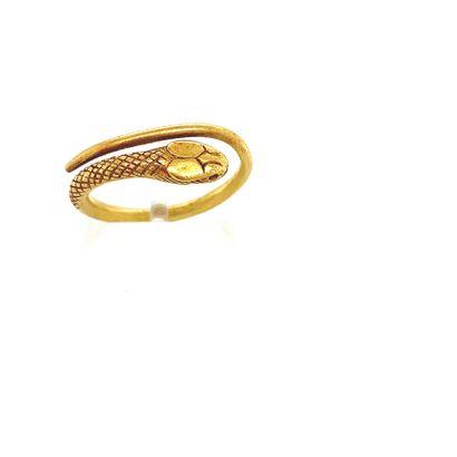 BAGUE en or (750) en forme de serpent enroulé....
