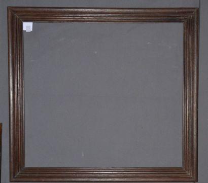 CADRE en chêne mouluré et patiné.  Fin du XIXème siècle  98 x 89 x 9 cm
