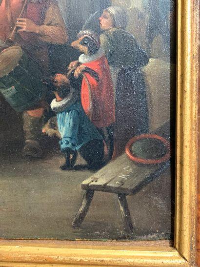 ECOLE FLAMANDE du XIXème siècle.  Le montreur de chien  Huile sur panneau monogrammé...