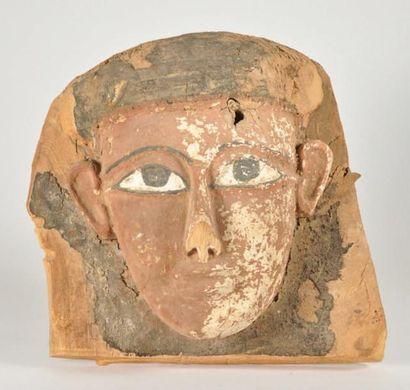 Masque de sarcophage fixe sur une partie...